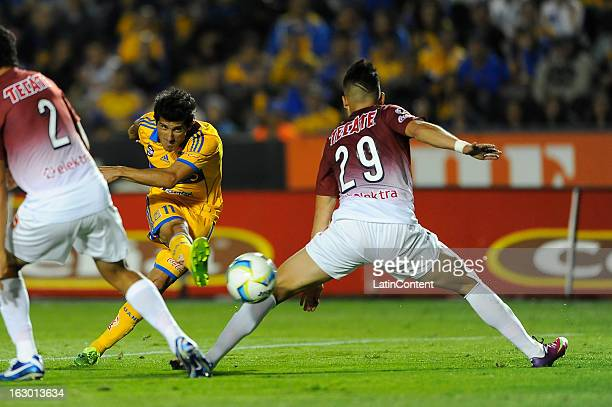 Damian Alvarez of Tigres hits the ball during the game between Tigres and Morelia as part of the Clausura 2013 on March 2 2013 in Monterrey Mexico