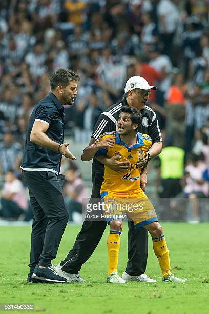 Damian Alvarez of Tigres is holded by staff members during the quarter finals second leg match between Monterrey and Tigres UANL as part of the...