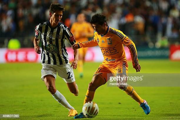Damian Alvarez of Tigres struggles for the ball with Jurgen Damm of Pachuca during a quarterfinal first leg match between Pachuca and Tigres as part...