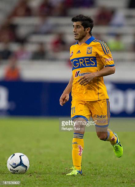 Damian Alvarez runs with the ball during a match between Atlas and Tigres UANL as part of the Apertura 2013 Liga MX at Jalisco Stadium on November...
