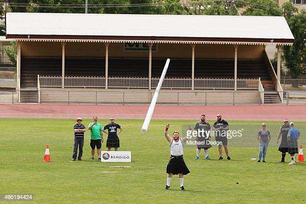 Damian Birkenhead takes part in the Caber Tossing discipline of the Highland Games during Bendigo Fit Weekend on November 1 2015 in Bendigo Australia
