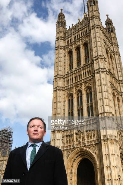 Damian Collins chairman of UK House of Commons' digital culture and sport committee poses for a photograph outside the Houses of Parliament in London...