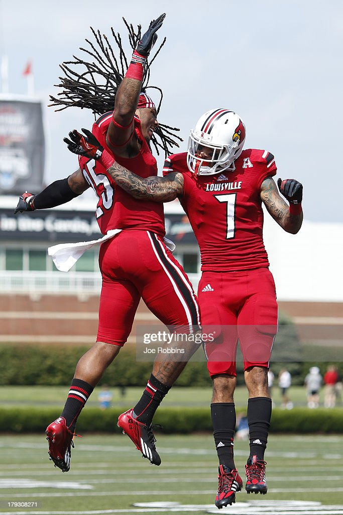 Damian Copeland #7 of the Louisville Cardinals celebrates with teammate Calvin Pryor #25 after a 34-yard touchdown reception in the first quarter of the game against the Ohio Bobcats at Papa John's Cardinal Stadium on September 1, 2013 in Louisville, Kentucky.