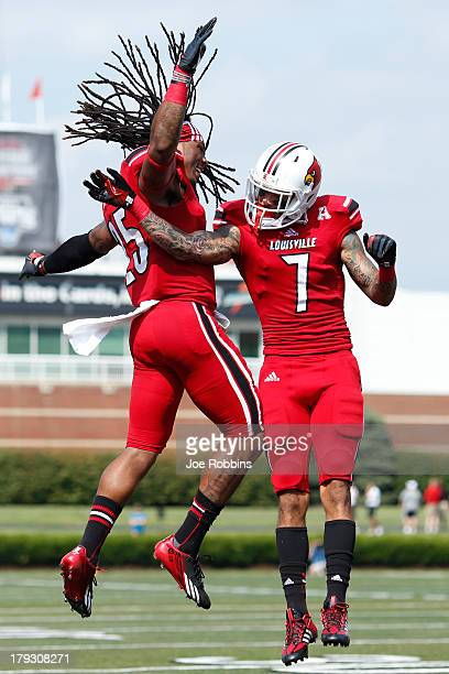Damian Copeland of the Louisville Cardinals celebrates with teammate Calvin Pryor after a 34yard touchdown reception in the first quarter of the game...