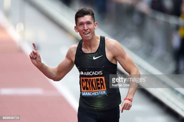 Damian Czykier of Poland celebrates after winning the mens 110 metres hurdles during the Great City Games on May 18 2018 in Manchester England