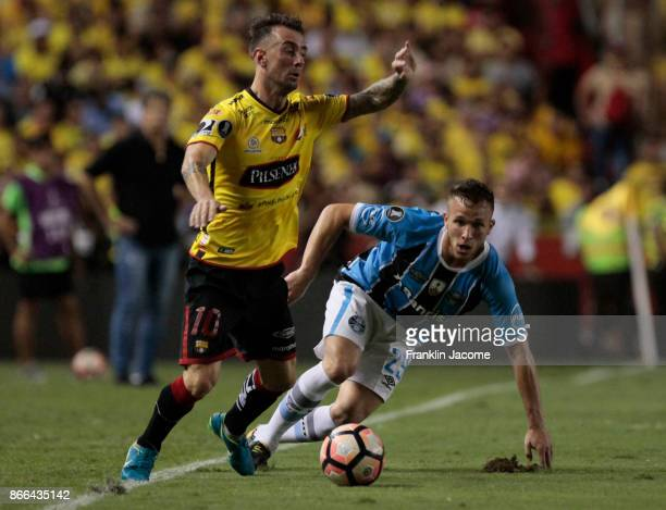 Damian Díaz of Barcelona SC competes for the ball with Arthur of Gremio the ball with during a first leg match between Barcelona SC and Gremio as...