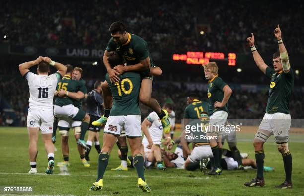 Damian de Allande celebrates with team mate Handre Pollard during the second test match between South Africa and England at Toyota Stadium on June 16...