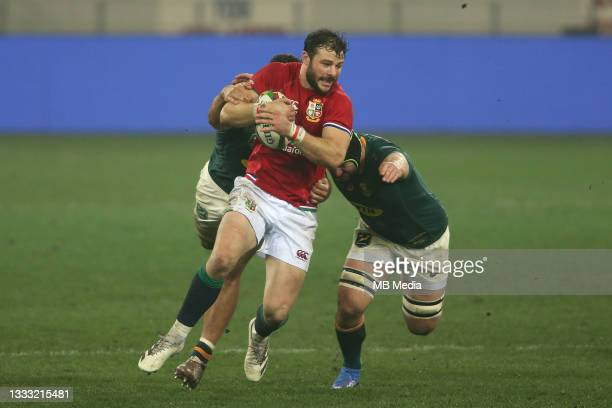 Damian de Allende and Marco van Staden of South Africa tackle Robbie Henshaw of the British & Irish Lions during the 3rd Test between South Africa...