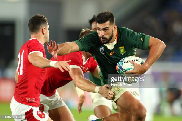 Damian de Allende of South Africa breaks past Tomos Williams of Wales before scoring his team's first try during the Rugby World Cup 2019 SemiFinal...