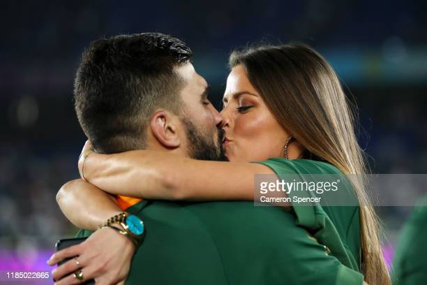Damian de Allende of South Africa celebrates with his girlfriend Domenica Vigliotti following his team's victory against England in the Rugby World...