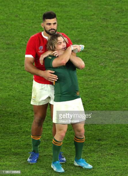 Damian de Allende of South Africa embraces teammate Faf de Klerk as they celebrate following their team's victory in the Rugby World Cup 2019...