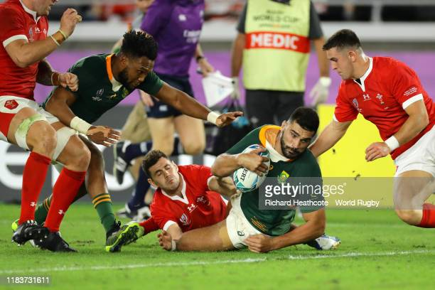 Damian de Allende of South Africa goes over to score his team's first try during the Rugby World Cup 2019 SemiFinal match between Wales and South...