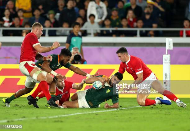 Damian de Allende of South Africa goes over to score his team's first try during the Rugby World Cup 2019 Semi-Final match between Wales and South...