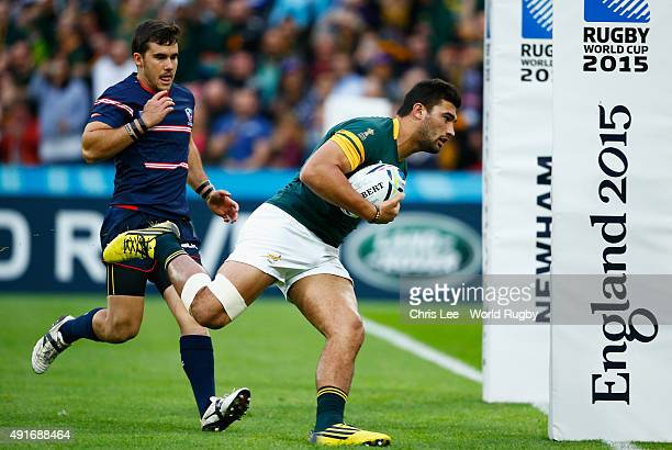 Damian De Allende of South Africa goes over to score their first try during the 2015 Rugby World Cup Pool B match between South Africa and USA at the...