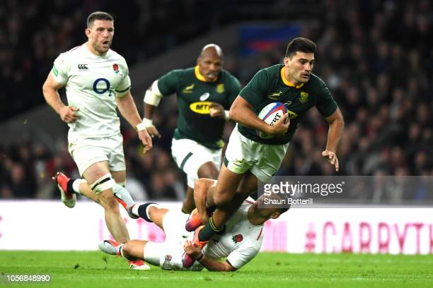 Damian de Allende of South Africa is tackled by Danny Care of England during the Quilter International match between England and South Africa at...