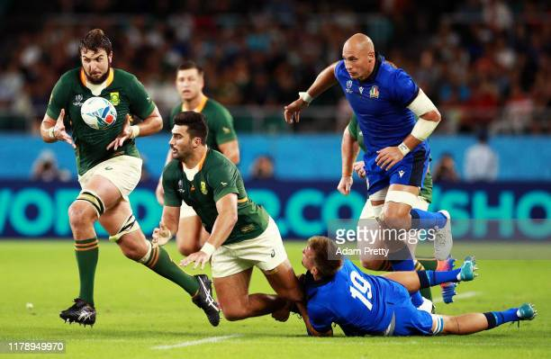 Damian De Allende of South Africa offloads the ball to Lodewyk De Jager of South Africa during the Rugby World Cup 2019 Group B game between South...