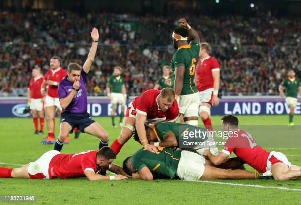 Damian de Allende of South Africa touches down to score his team's first try during the Rugby World Cup 2019 SemiFinal match between Wales and South...