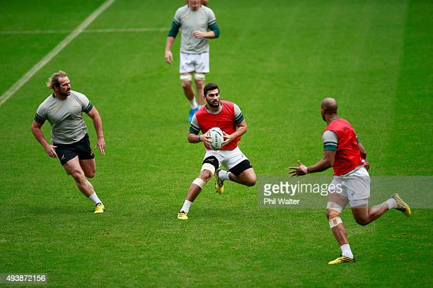 Damian De Allende of South Africa warms up with a game of touch rugby during a South Africa Captain's Run at Twickenham Stadium on October 23 2015 in...