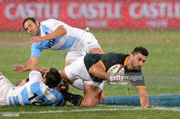 Damian de Allende of the Springboks tackled by Juan Martin Hernandez of Argentina during The Castle Rugby Championship match between South Africa and...