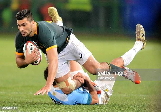 Damian de Allende of the Springboks tackled by Lucas Gonzalez Amorosino of Argentina during The Castle Rugby Championship match between South Africa...