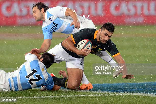 Damian de Allende of the Springboks tackled during The Castle Rugby Championship match between South Africa and Argentina at Loftus Versfeld on...