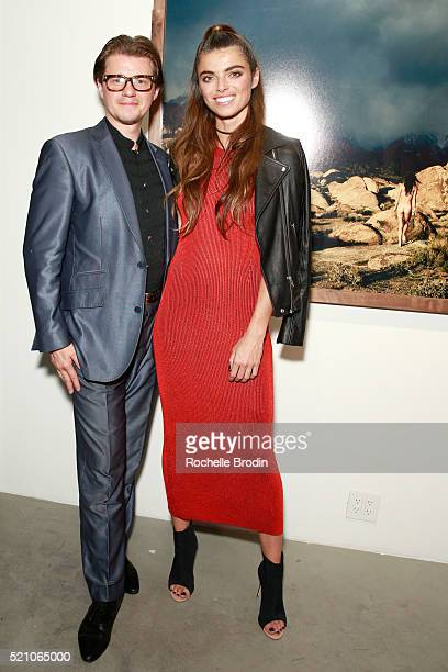 Damian de Langeron and photographer Monroe attend the Photo Femmes Exhibition Opening at De Re Gallery featuring the work of Ashley Noelle Bojana...