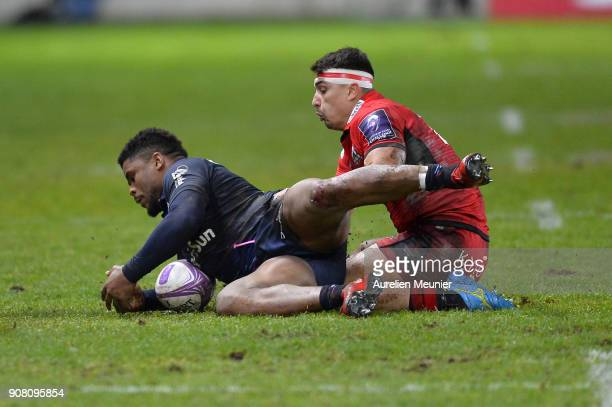 Damian Hoyland of Edinburgh and Jonathan Danty of Stade Francais fight for the ball during the European Rugby Challenge Cup match between Stade...