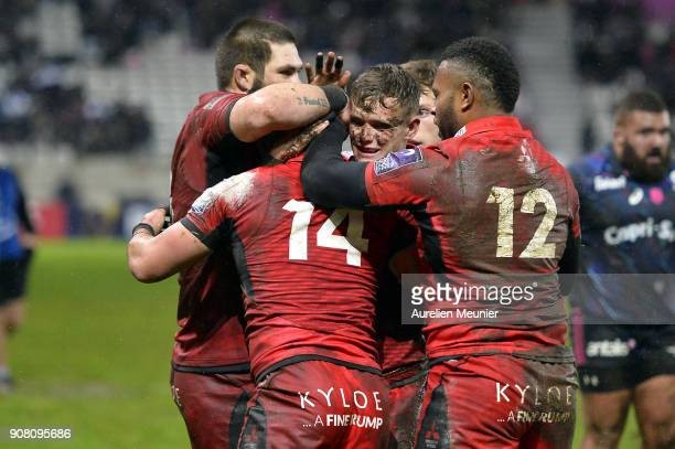 Damian Hoyland of Edinburgh is congratulated by teammates after scoring a try during the European Rugby Challenge Cup match between Stade Francais...