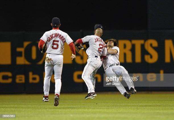 Damian Jackson and Johnny Damon of the Boston Red Sox collide while chasing a ball against the Oakland A's in the eighth inning during Game 5 of the...
