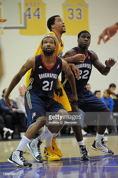 Damian Johnson and Adrian Thomas of the Bakersfield Jam box out Brandon Costner of the Los Angeles DFenders during a game at Toyota Sports Center on...