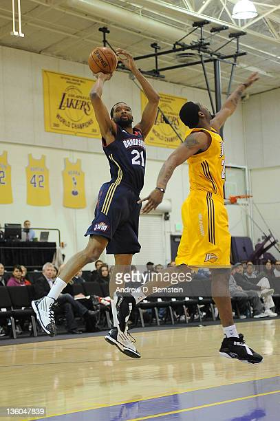 Damian Johnson of the Bakersfield Jam attempts a shot against Orien Greene of the Los Angeles DFenders during a game at Toyota Sports Center on...