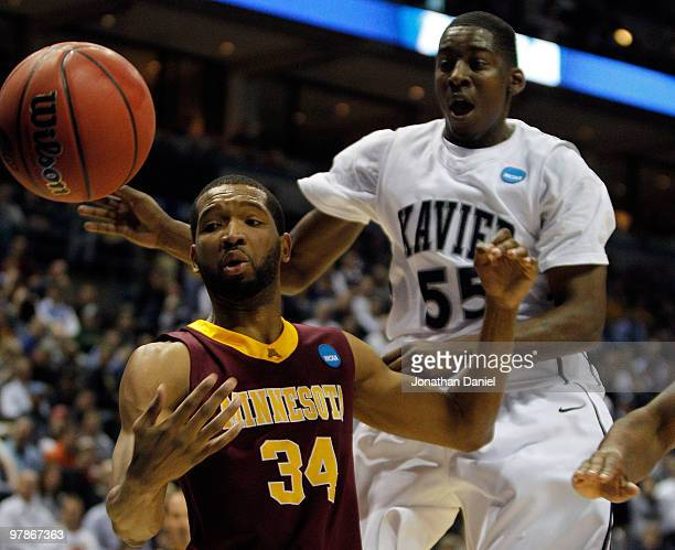 Damian Johnson of the Minnesota Golden Gophers and Jordan Crawford of the Xavier Musketeers look at the ball during the first round of the 2010 NCAA...