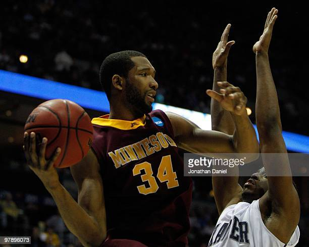 Damian Johnson of the Minnesota Golden Gophers looks to pass the ball against the Xavier Musketeers during the first round of the 2010 NCAA men's...