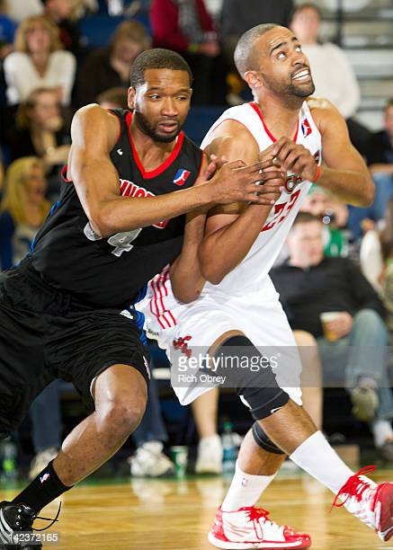 Damian Johnson of the Springfield Armor moves Lawrence Hill of the Maine Red Claws away from the basket on a foul shot during the game on April 1...