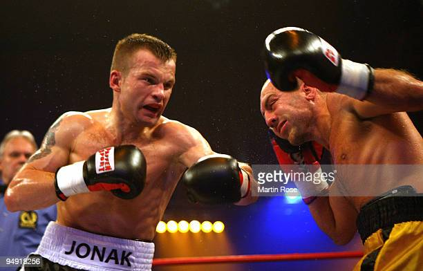 Damian Jonak of Poland exchanges punches with Nicolas Guisset of France during the super welterweight fight during the Universum Champions night...