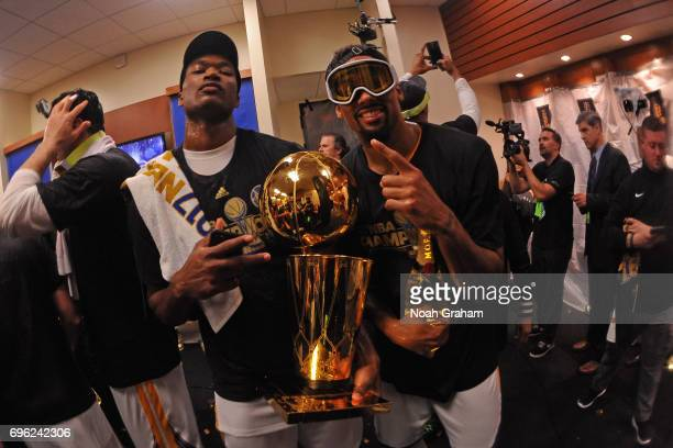 Damian Jones and James Michael McAdoo of the Golden State Warriors celebrate with the Larry O'Brien Trophy after winning Game Five of the 2017 NBA...