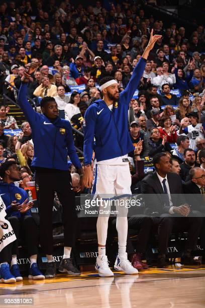 Damian Jones and JaVale McGee of the Golden State Warriors react during the game against the Sacramento Kings on March 16 2018 at ORACLE Arena in...