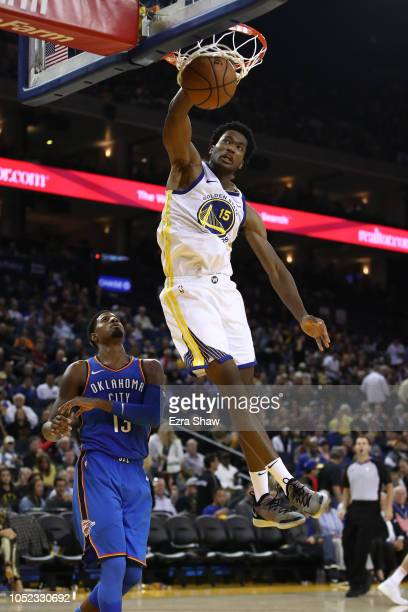 Damian Jones of the Golden State Warriors dunks the ball against the Oklahoma City Thunder during their NBA game at ORACLE Arena on October 16 2018...