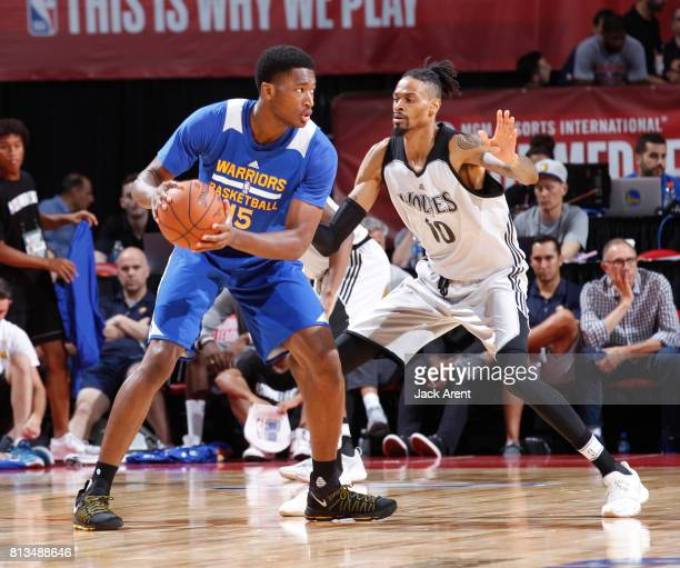 Damian Jones of the Golden State Warriors handles the ball against Raphiael Putney of the Minnesota Timberwolves during the 2017 Summer League on...