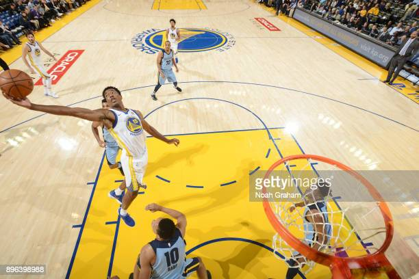 Damian Jones of the Golden State Warriors handles the ball against the Memphis Grizzlies on December 20 2017 at ORACLE Arena in Oakland California...