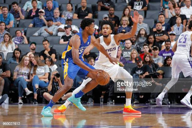 Damian Jones of the Golden State Warriors handles the ball against Marvin Bagley III of the Sacramento Kings on July 3 2018 at Golden 1 Center in...