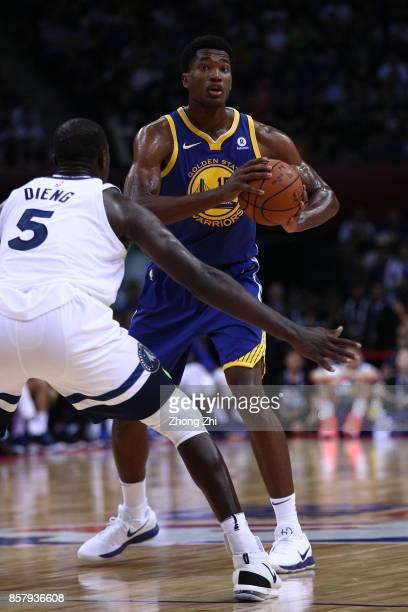 Damian Jones of the Golden State Warriors in action against Gorgui Dieng of the Minnesota Timberwolves during the game between the Minnesota...