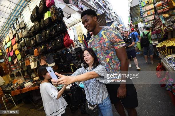 Damian Jones of the Golden State Warriors takes a selfie with a fan around Hong Kong as part of the 2017 Global Games China on October 3 2017 in Hong...