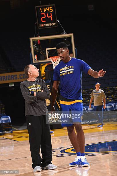 Damian Jones of the Golden State Warriors talks with assistant coach Ron Adams before the game against the Dallas Mavericks on November 9 2016 at...