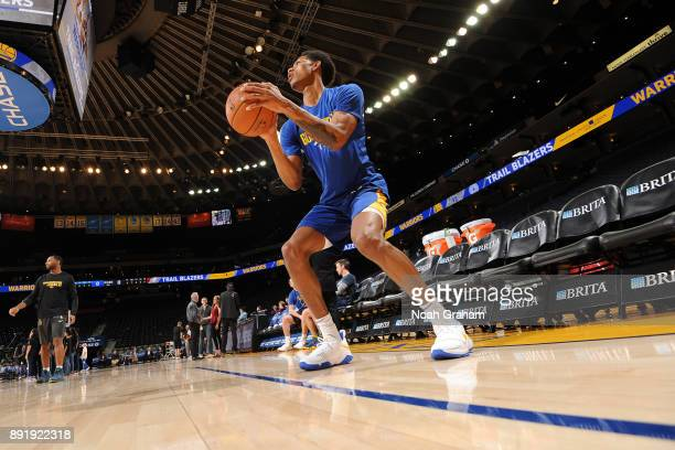 Damian Jones of the Golden State Warriors warms up prior to the game against the Portland Trail Blazers on December 11 2017 at ORACLE Arena in...