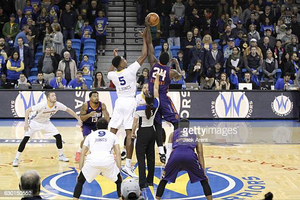Damian Jones of the Santa Cruz Warriors and Johnny O'Bryant III of the Northern Arizona Suns go up for the opening tip off before the game on...