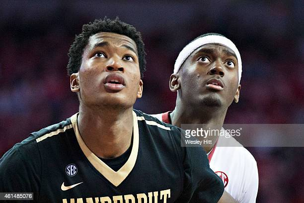 Damian Jones of the Vanderbilt Commodores blocks out Bobby Portis of the Arkansas Razorbacks at Bud Walton Arena on January 10 2015 in Fayetteville...