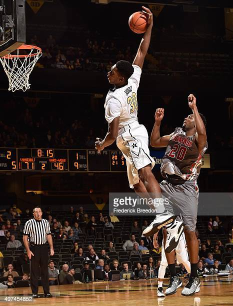 Damian Jones of the Vanderbilt Commodores goes up for a dunk against Tyrell Nelson of GardnerWebb during the second half at Memorial Gym on November...