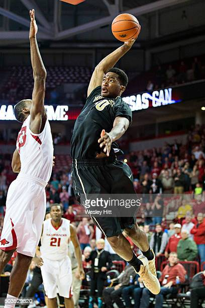 Damian Jones of the Vanderbilt Commodores goes up for the game-tying dunk in regulation over Moses Kingsley of the Arkansas Razorbacks at Bud Walton...