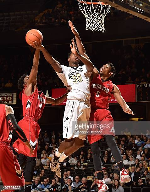 Damian Jones of the Vanderbilt Commodores plays against Chris Horton of the Austin Peay Governors at Memorial Gym on November 13 2015 in Nashville...